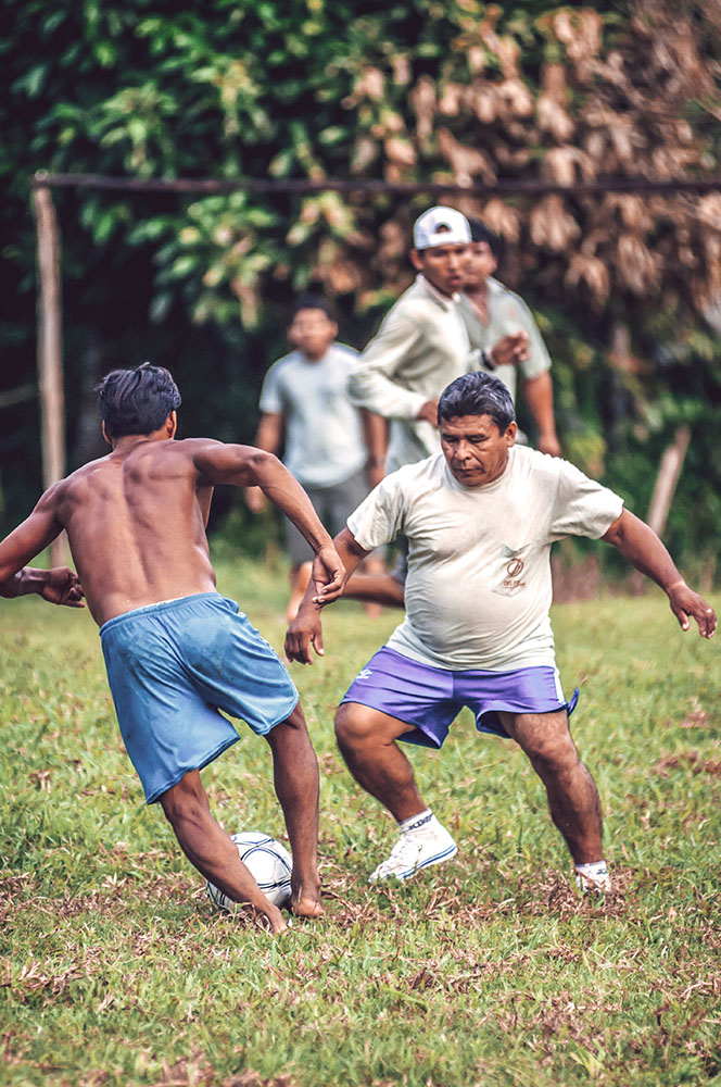 LORETO, PERU - JANUARY 02: Unidentified locals playing football