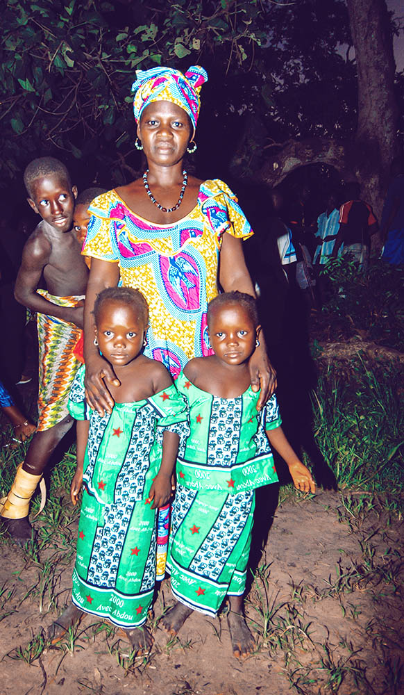 SENEGAL - SEPTEMBER 19: Mother and her twin daughters posing for