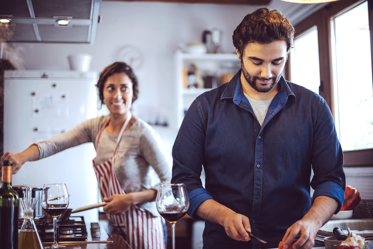 Young couple cooking. Man and woman in their kitchen