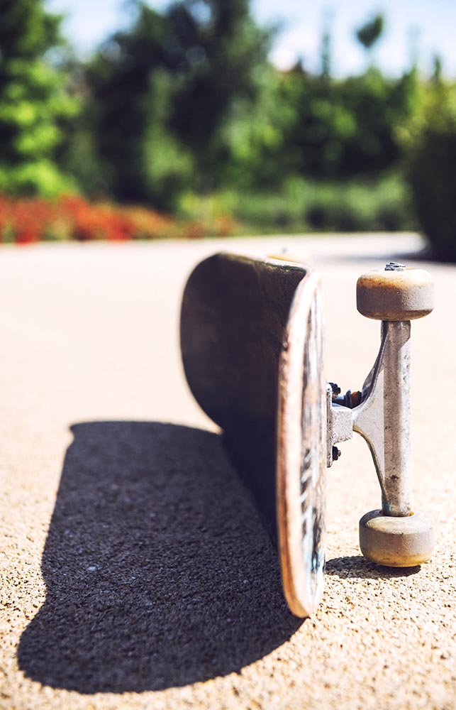 Old used skateboard over the ground