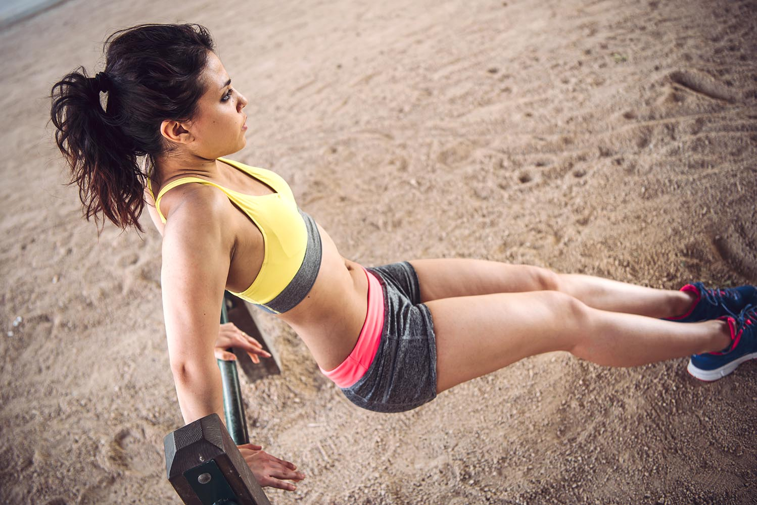 Young Woman working out outdoors and having fun