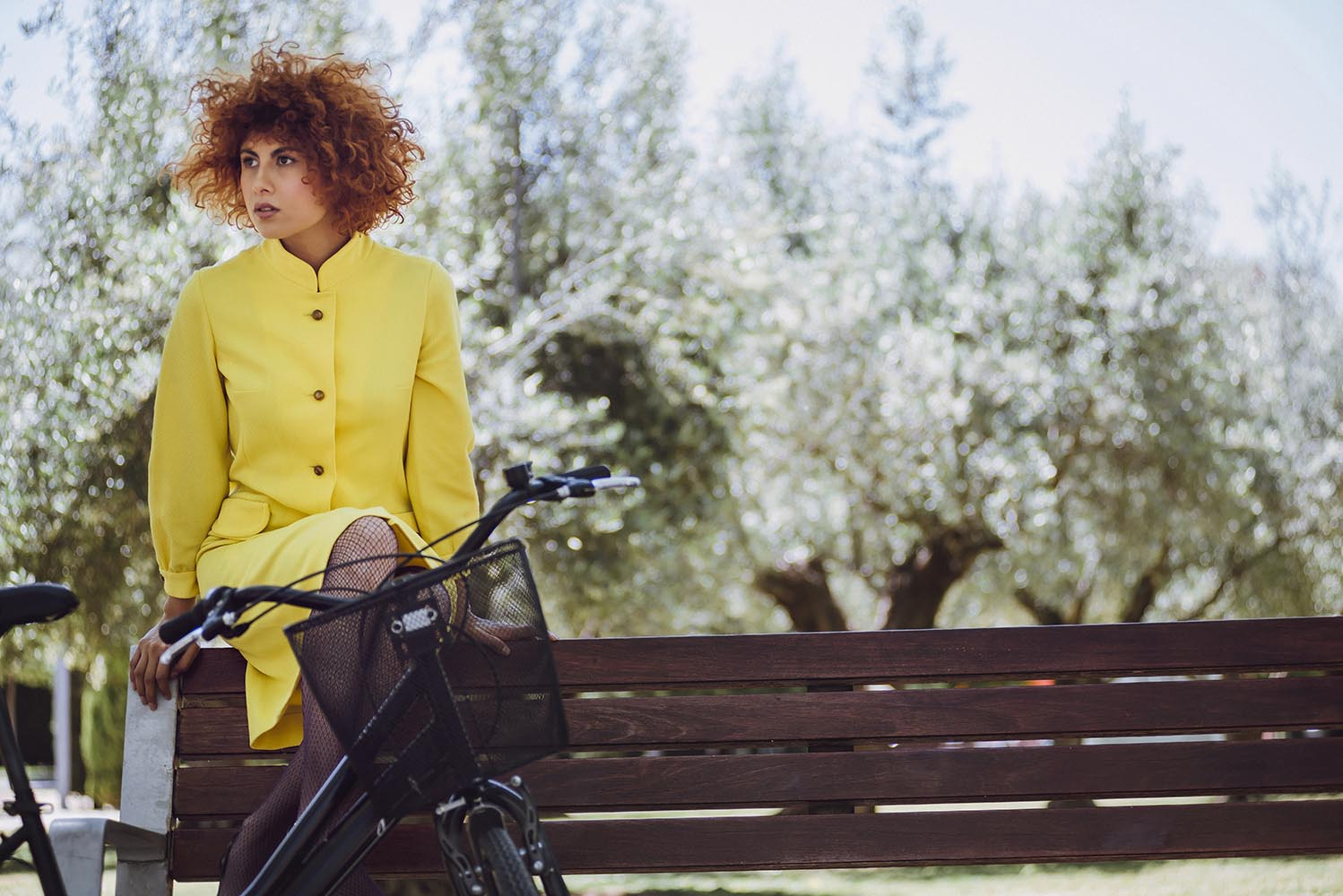 Redhaired beauty woman fashion girl on bicycle with chinesse umb