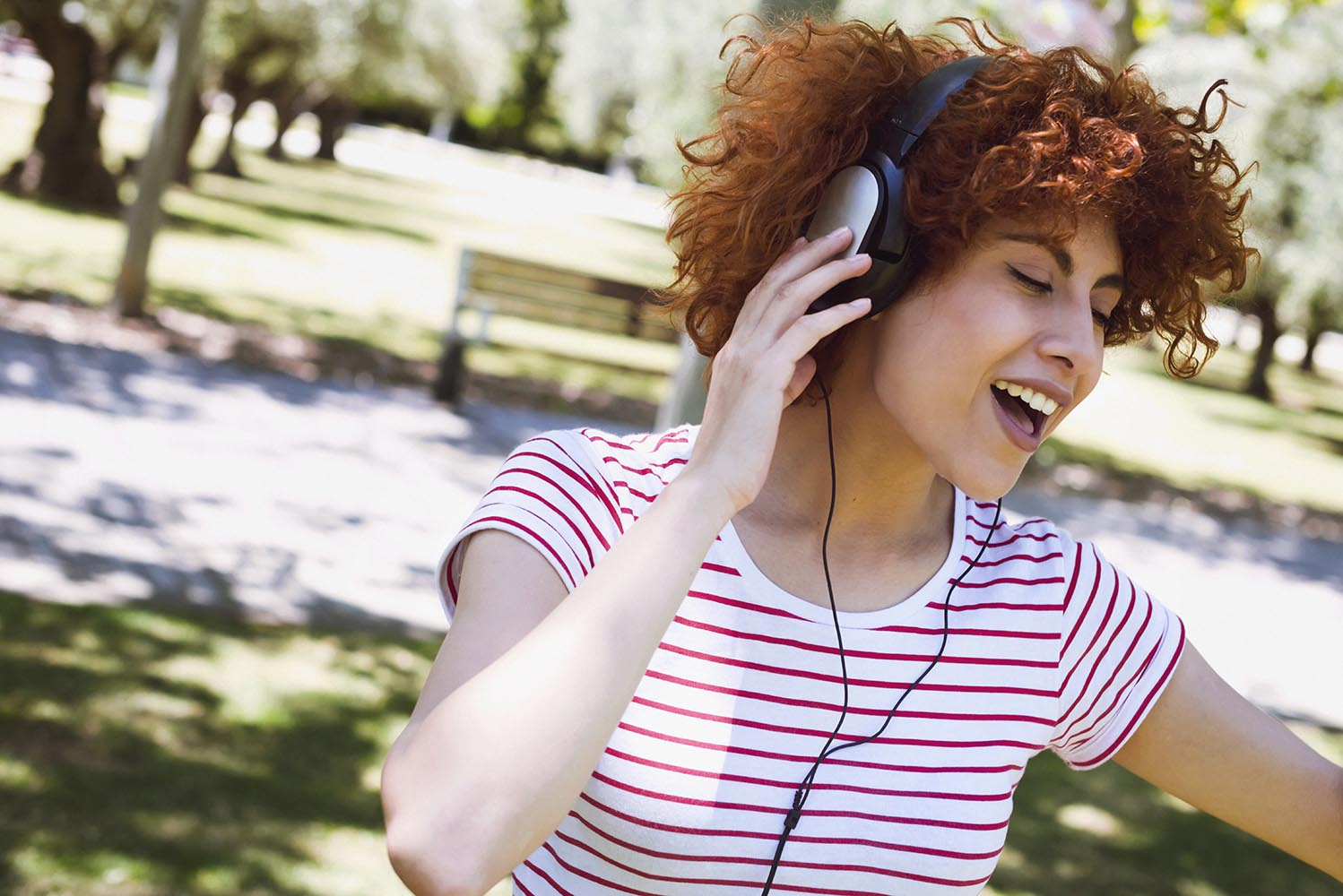 Young beautiful brunette woman girl listening music headphones o