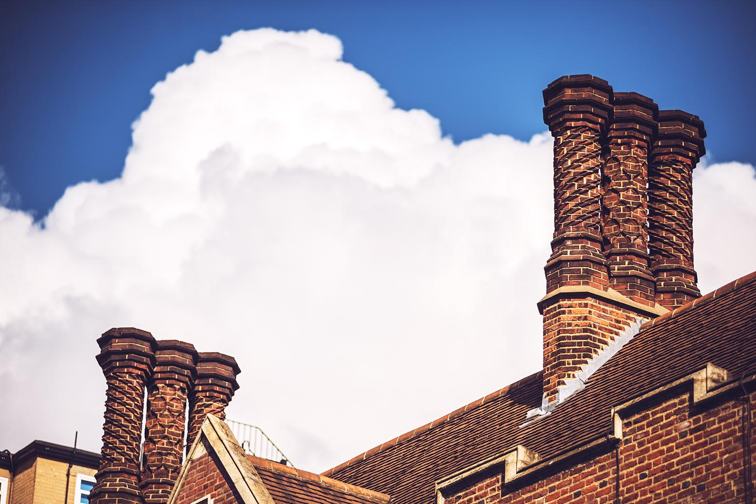 Brick chimney over clouds.