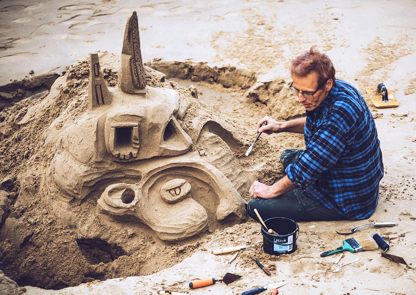 Architect building a beautiful castle of sand