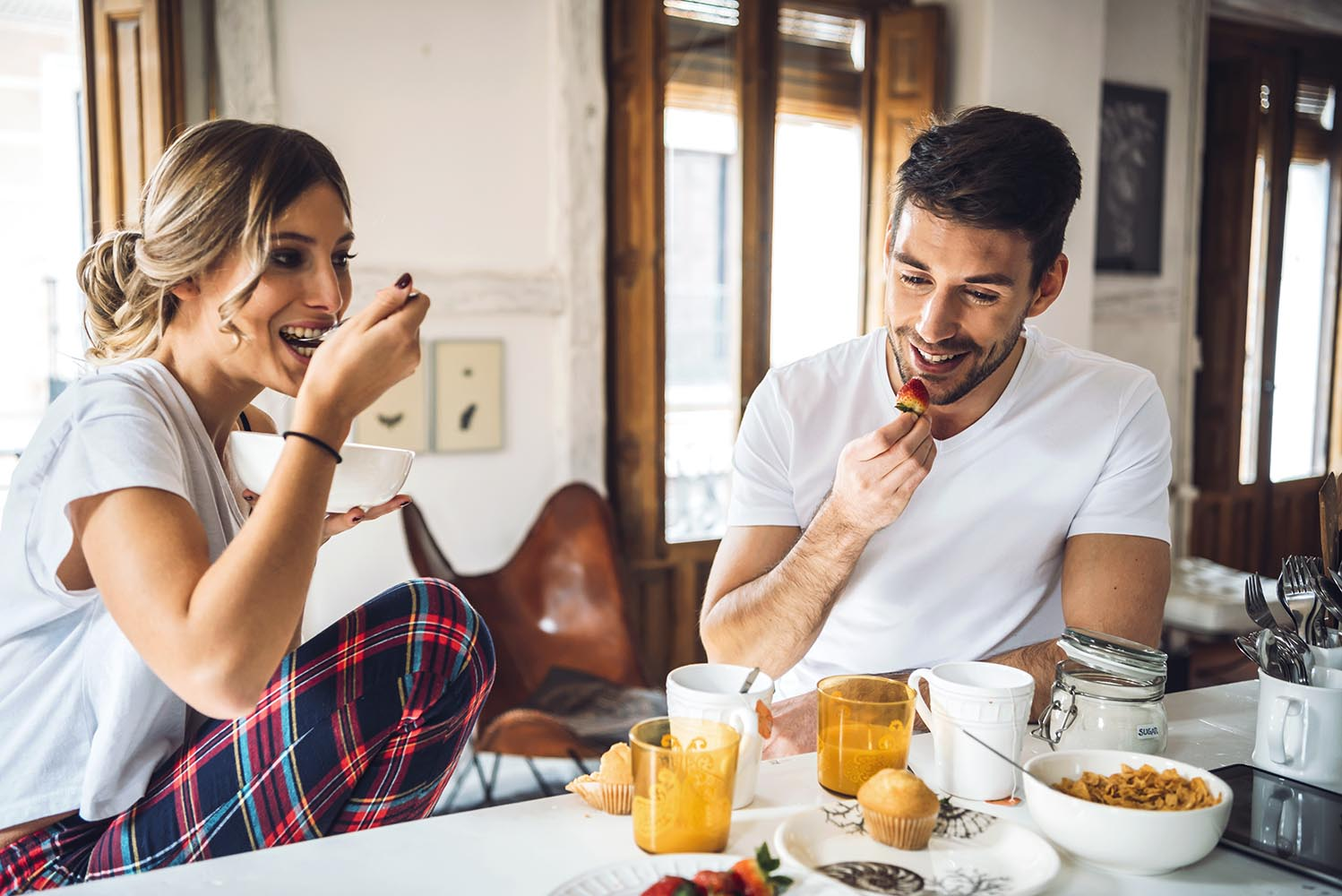 Couple having breakfast in morning