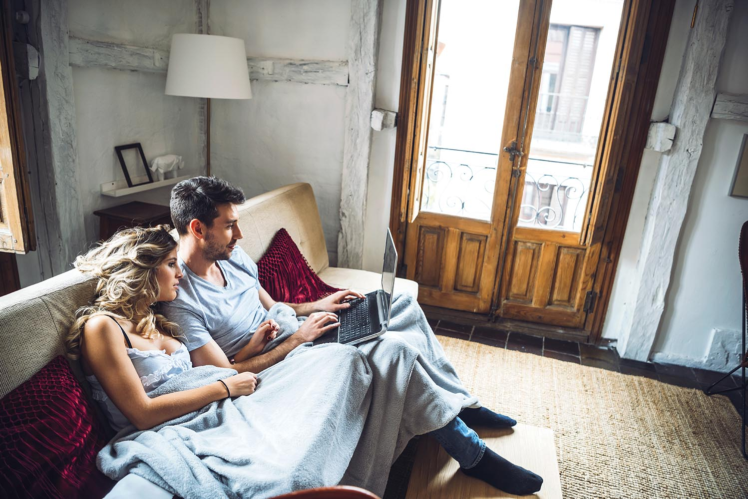 Sweet couple on couch with laptop