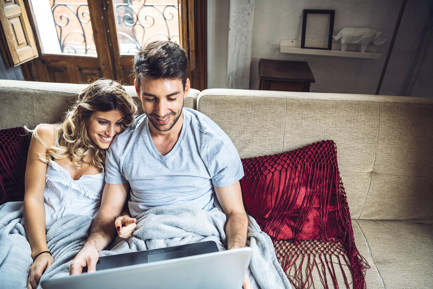 Couple enjoying time with laptop