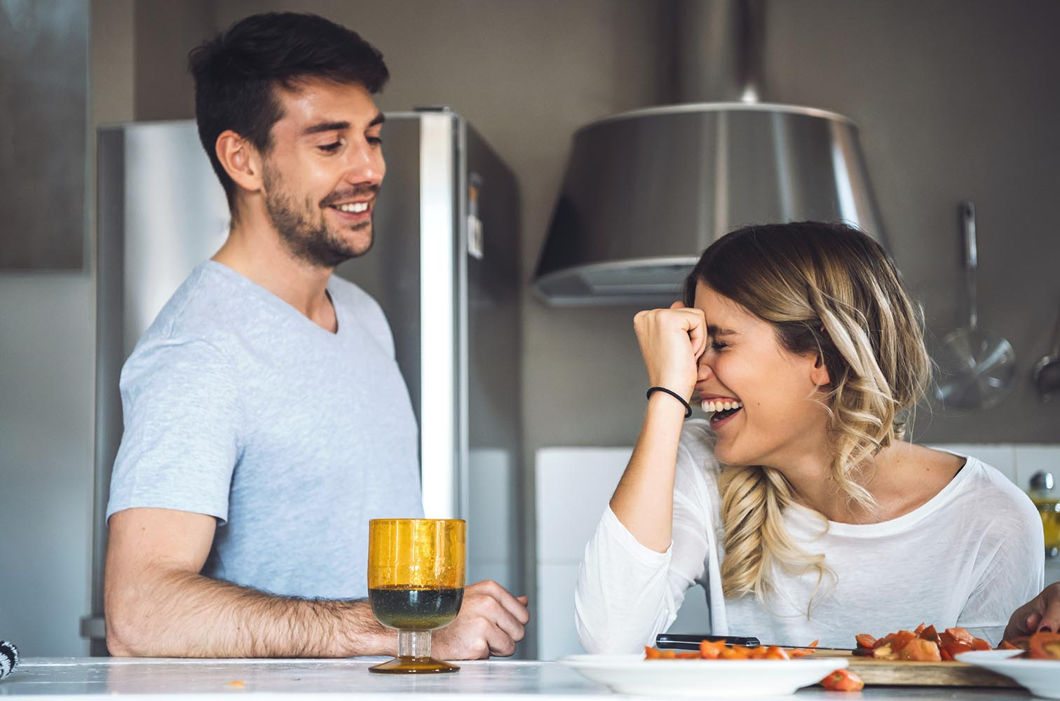 Cheerful young couple at kitchen