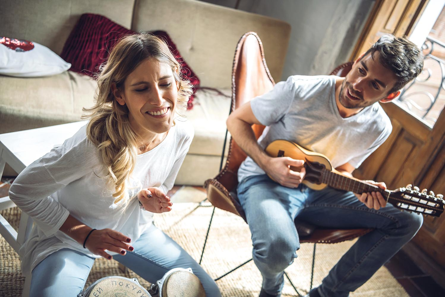 Sweet happy couple playing music