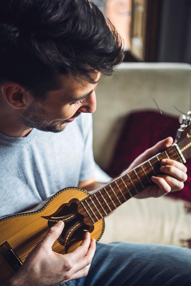 Man playing small guitar