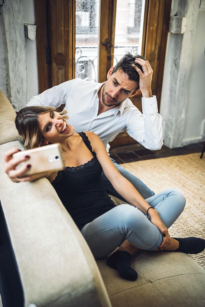 Lovely couple playing while taking selfie