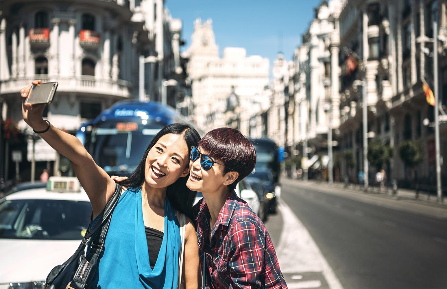 Tourists taking selfie on street