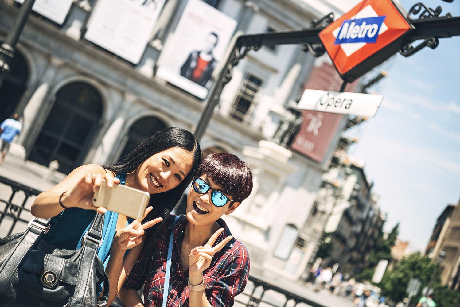 Lovely tourists taking selfie on street