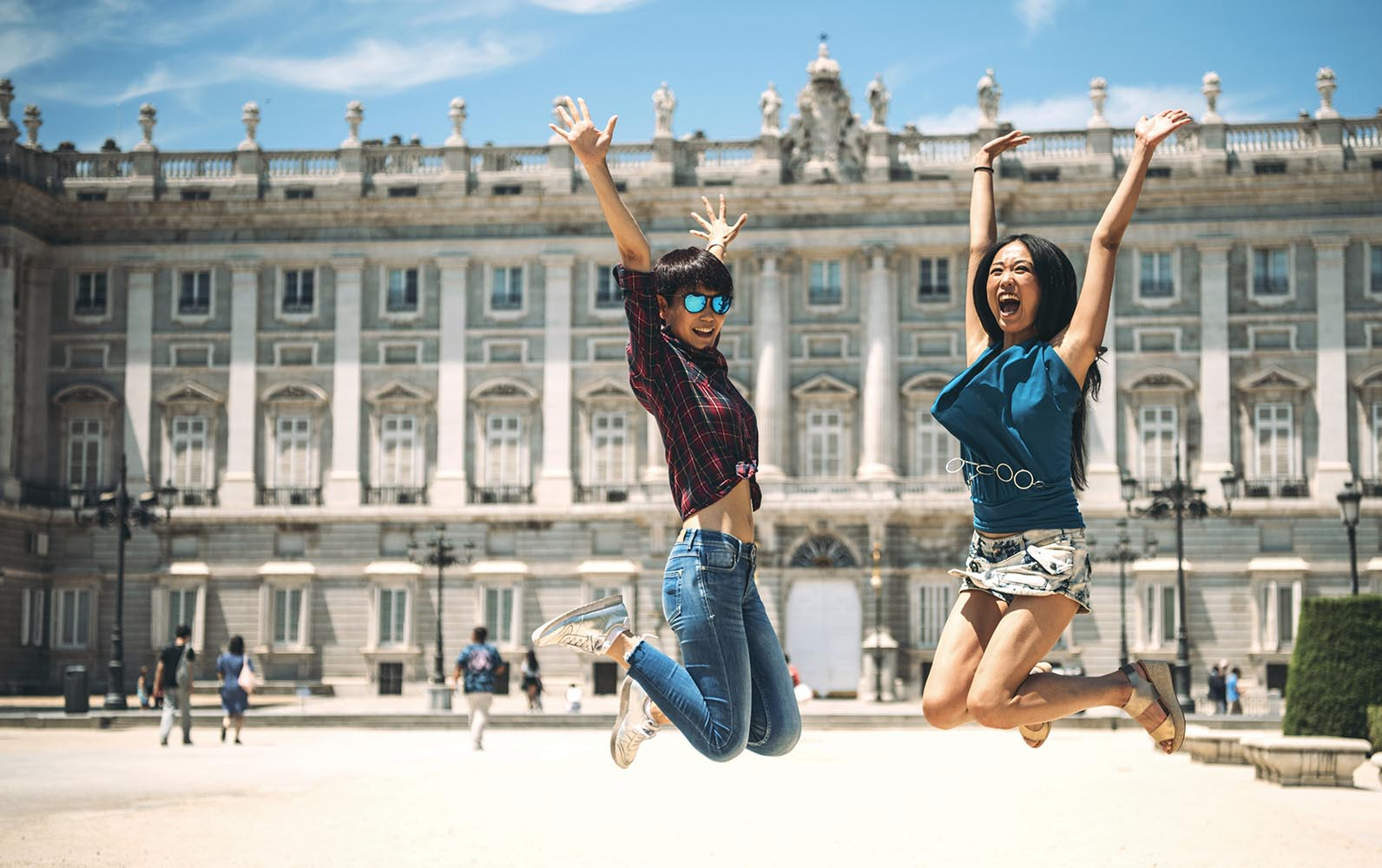 Cheerful female tourists in jump