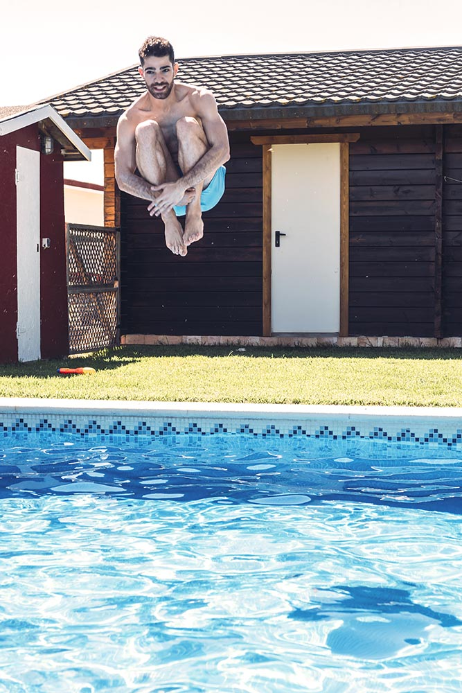 Man jumping into pool