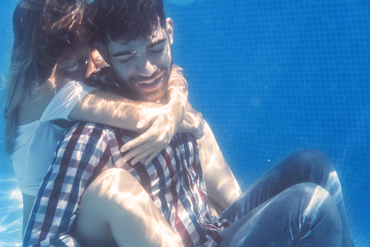 Couple embracing underwater