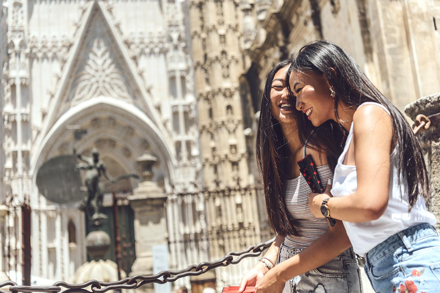 Chinese women smiling walking by cathedral