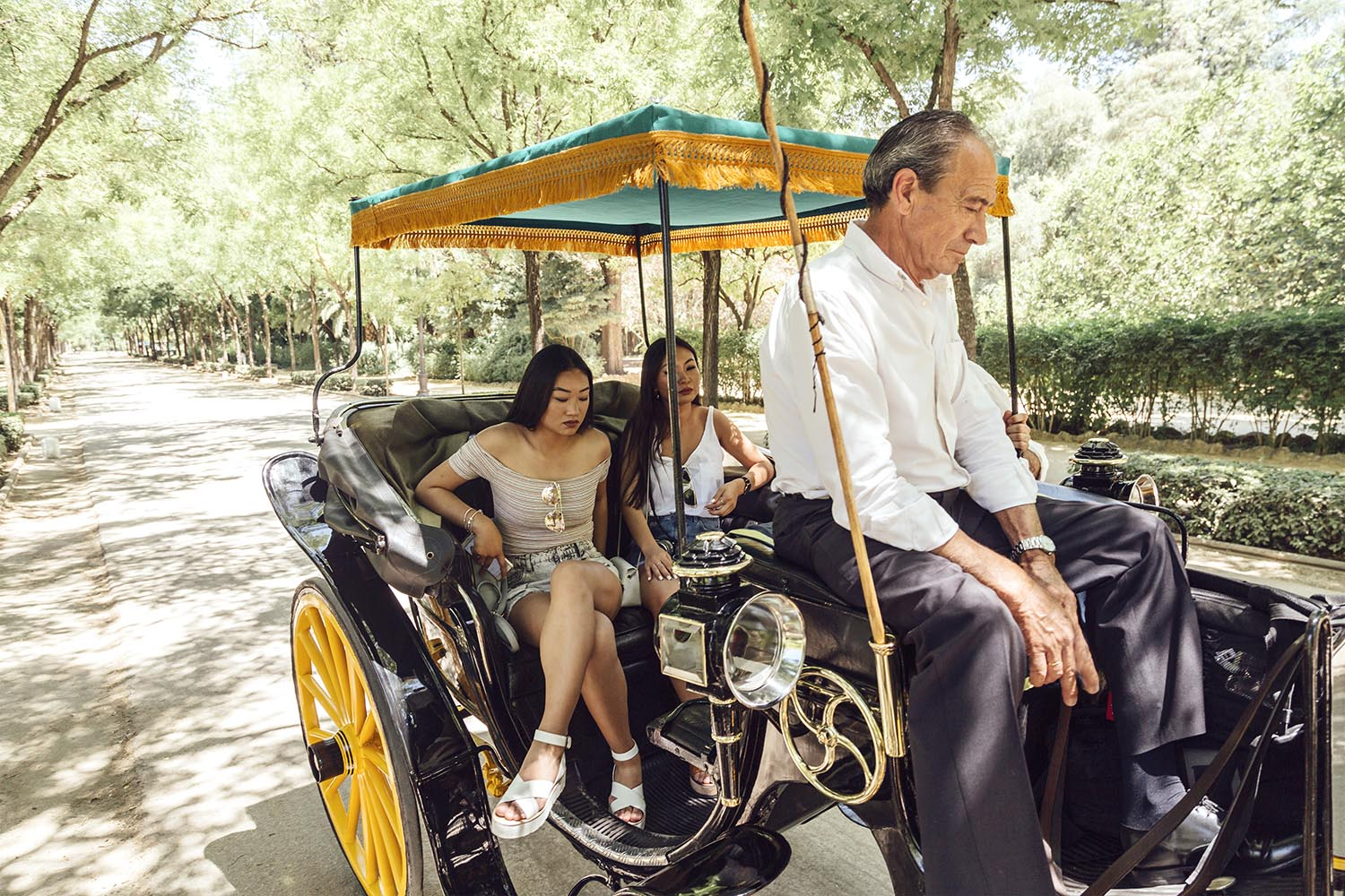 Chinese tourists riding in carriage