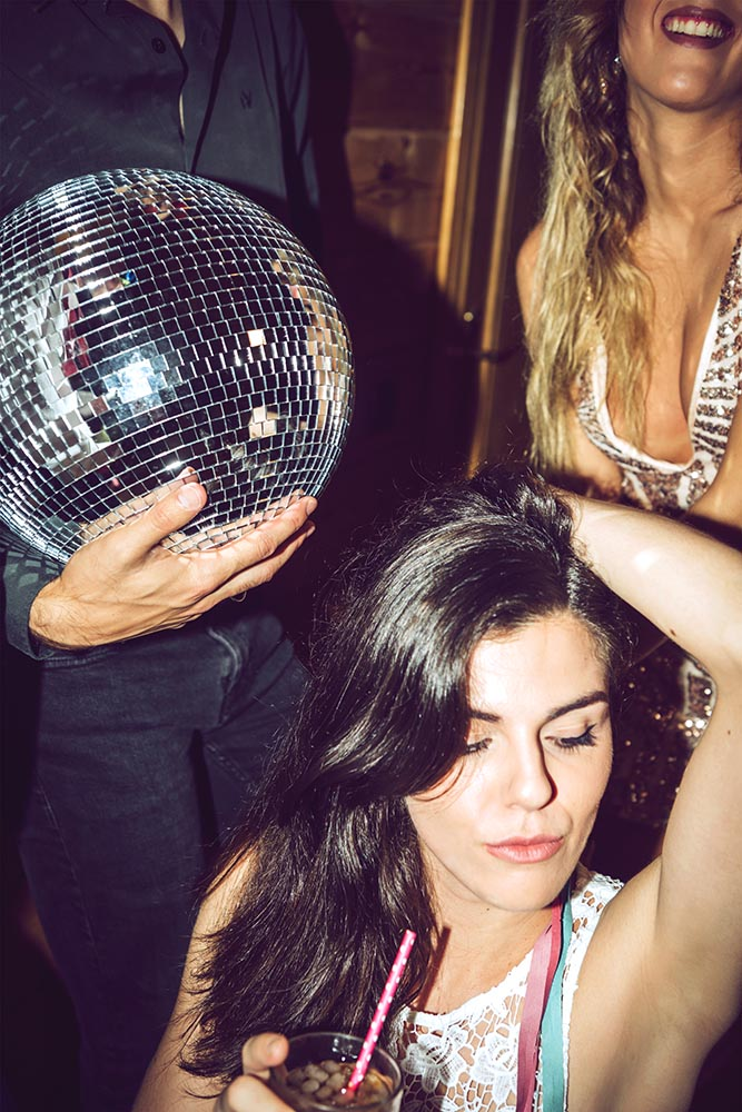 People on party with disco ball