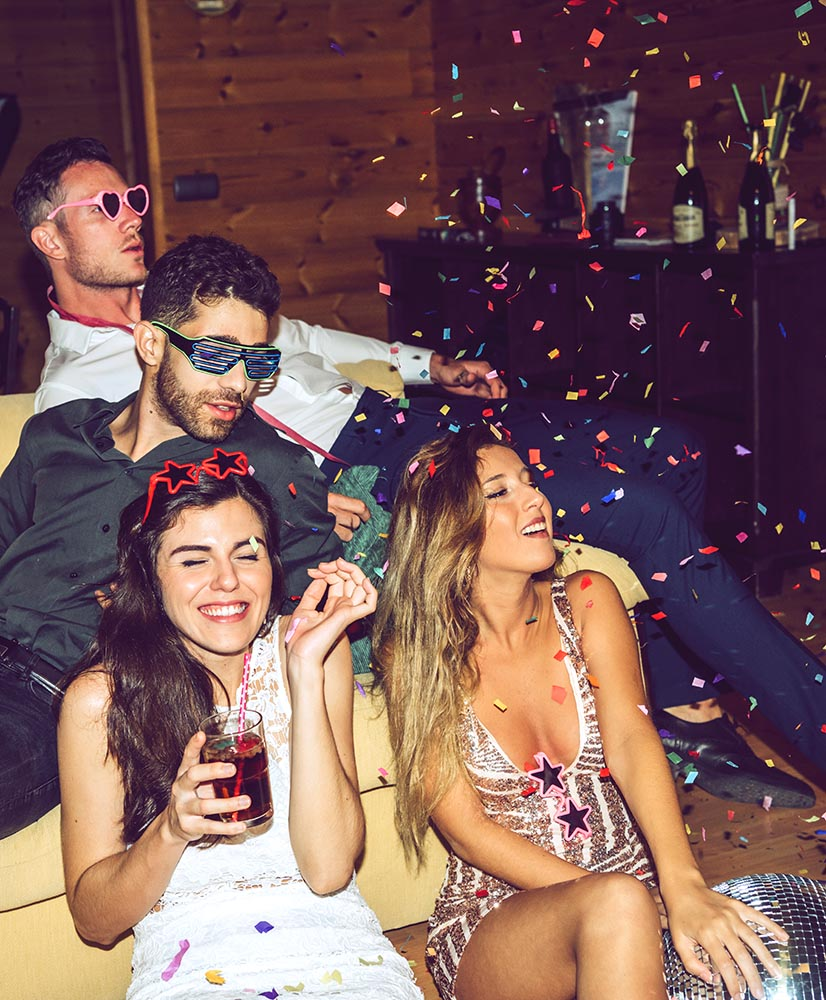 Glamour people with drinks and confetti