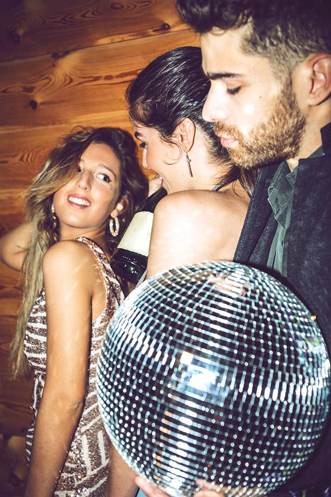 Glamour friends on party with disco ball