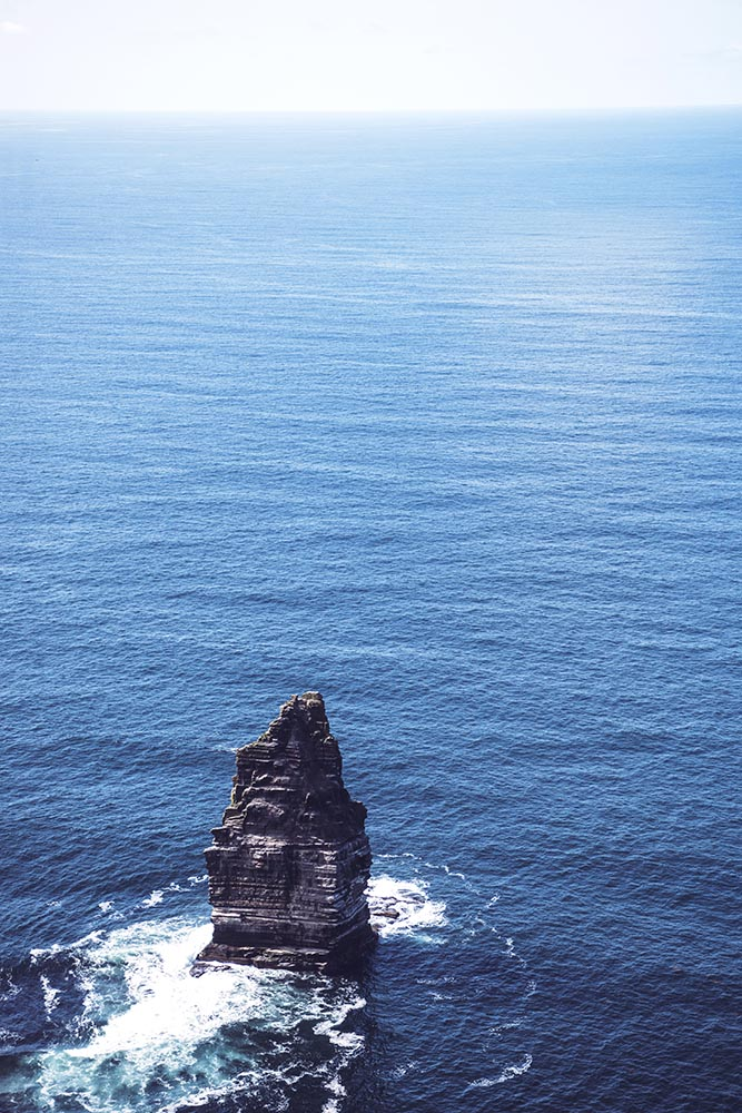 View of rock in ocean from Cliffs of Moher, Ireland.