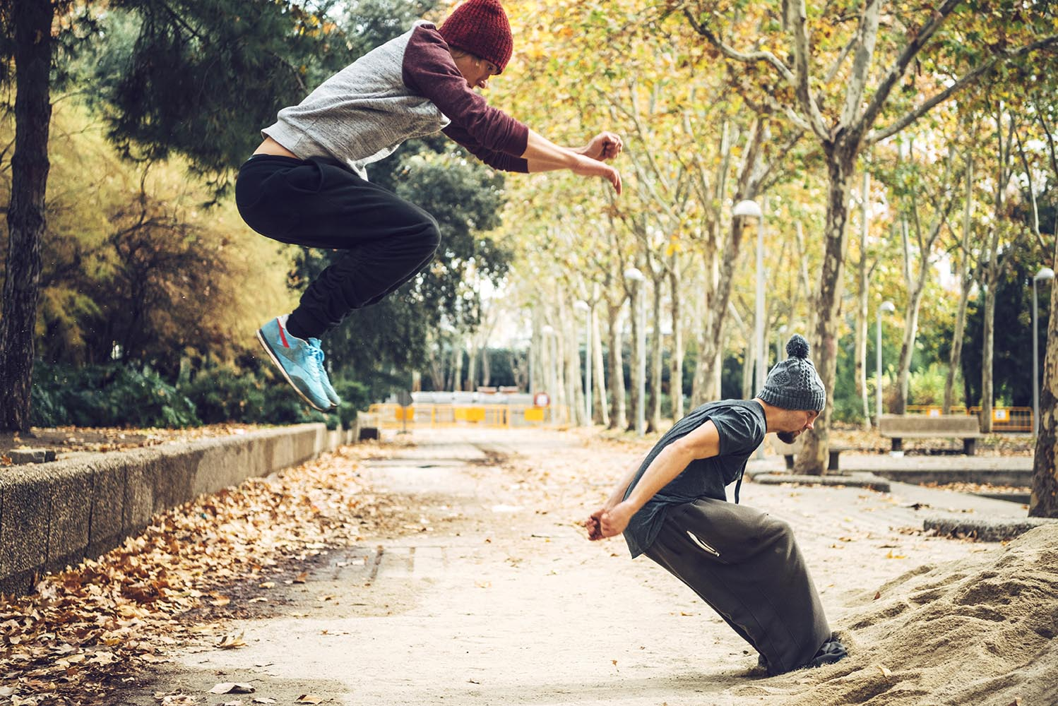 Two men training parkour in park