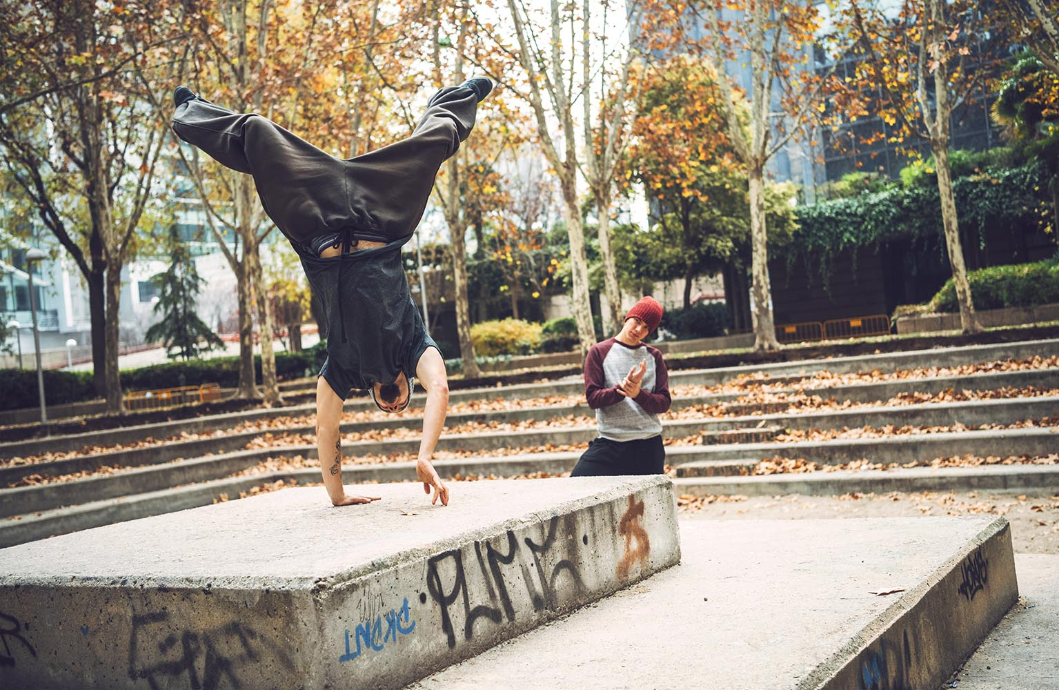 Parkour athletes training together in park