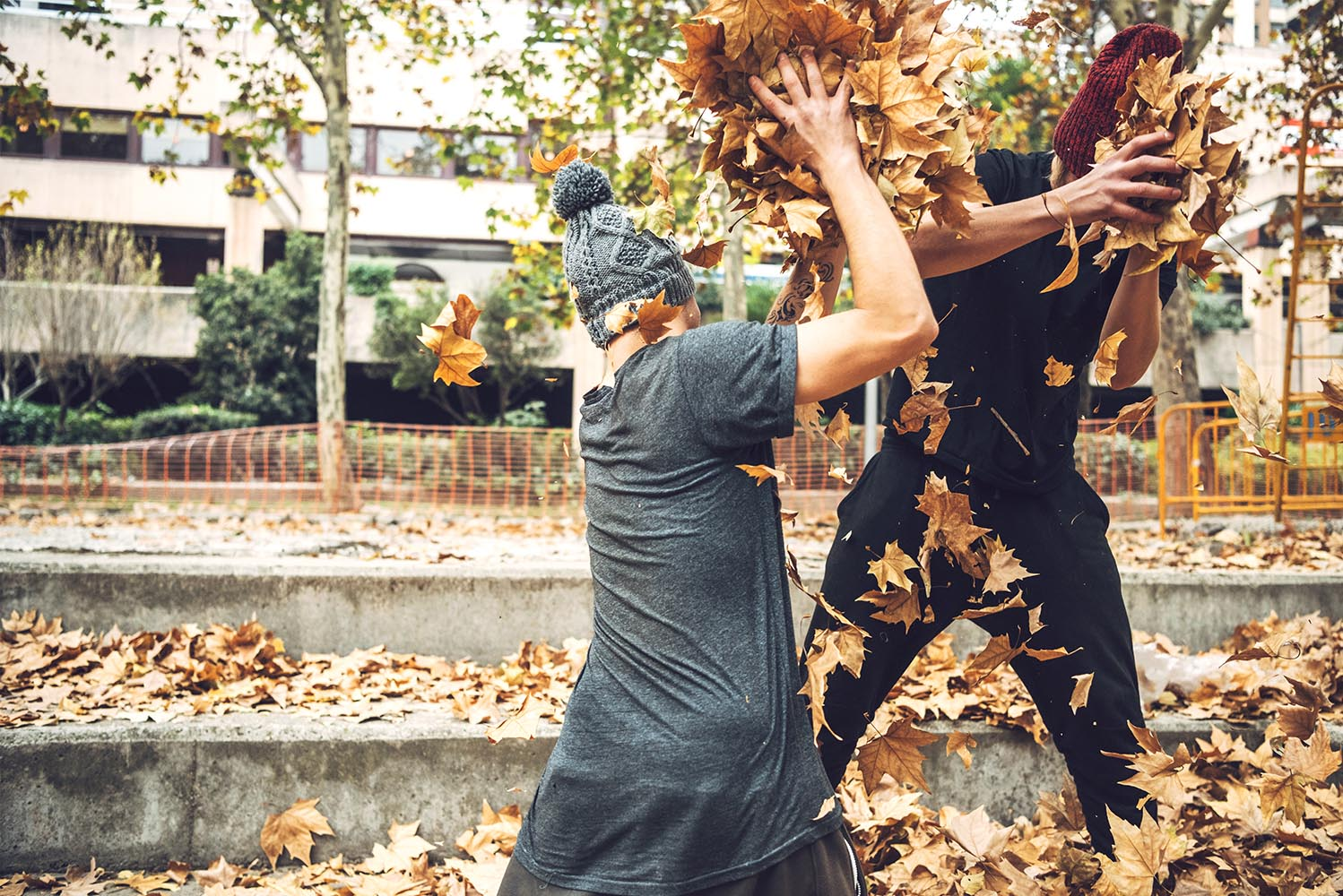 Freerunners playing with leaves in park