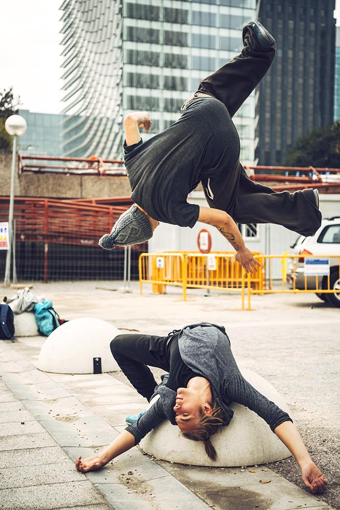 Sportive men training parkour playfully