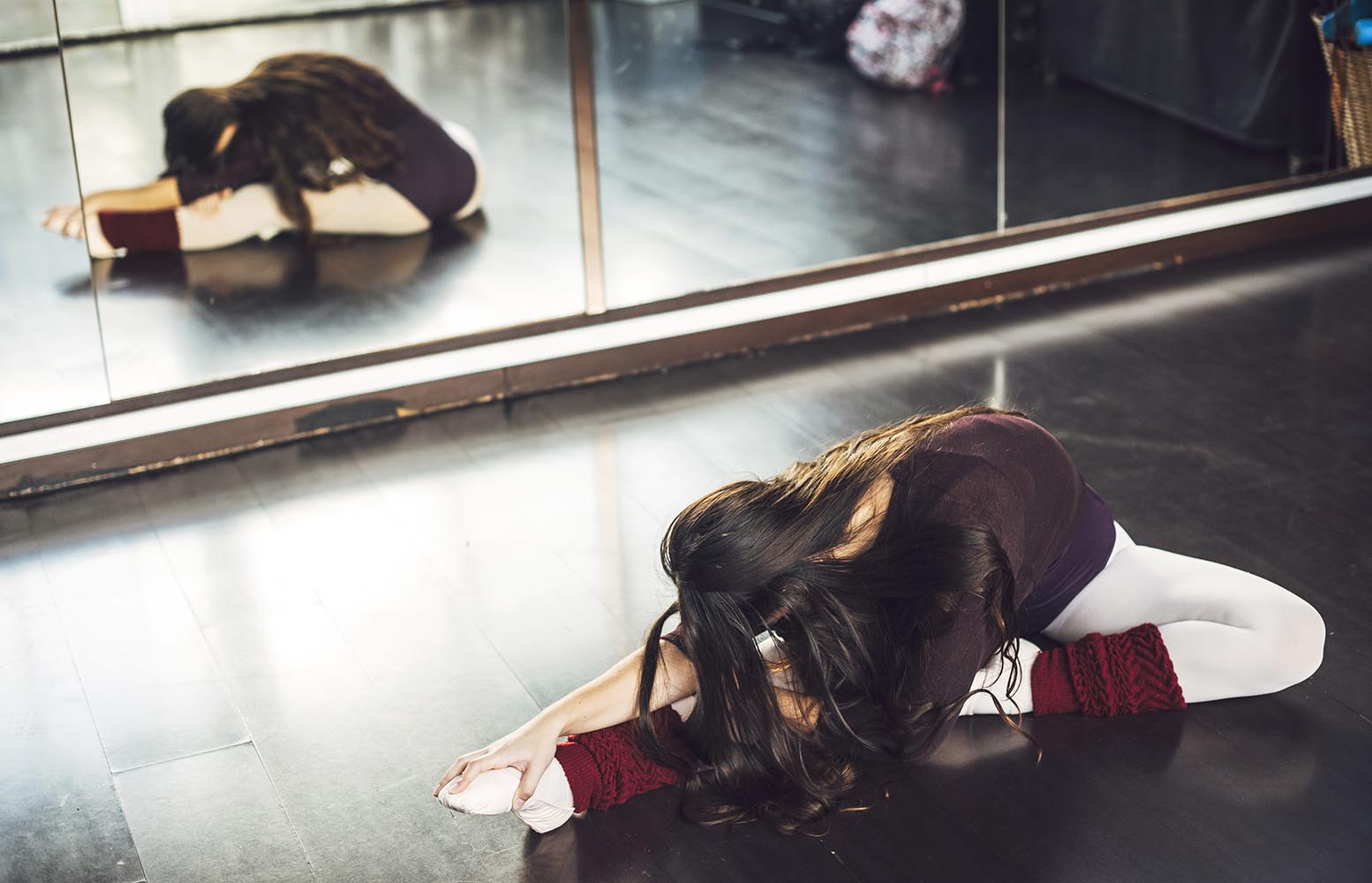 Woman stretching in ballet studio