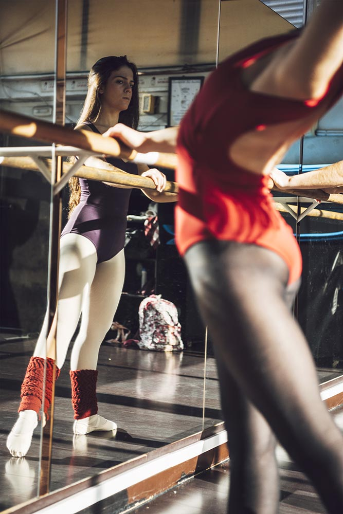 Professional dancer warming with barre