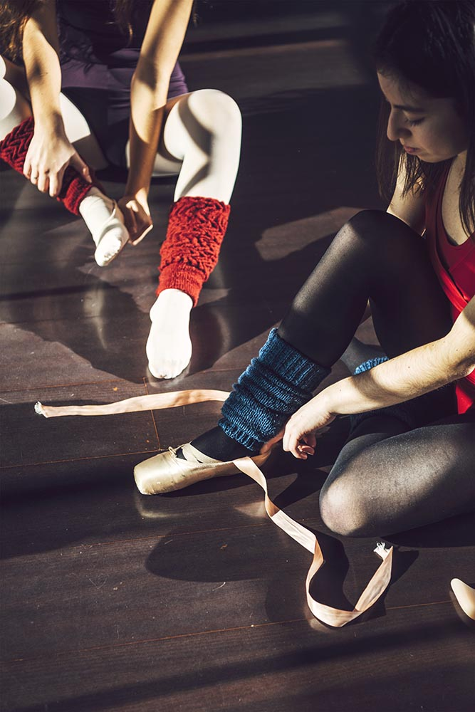 Women putting on pointe shoes