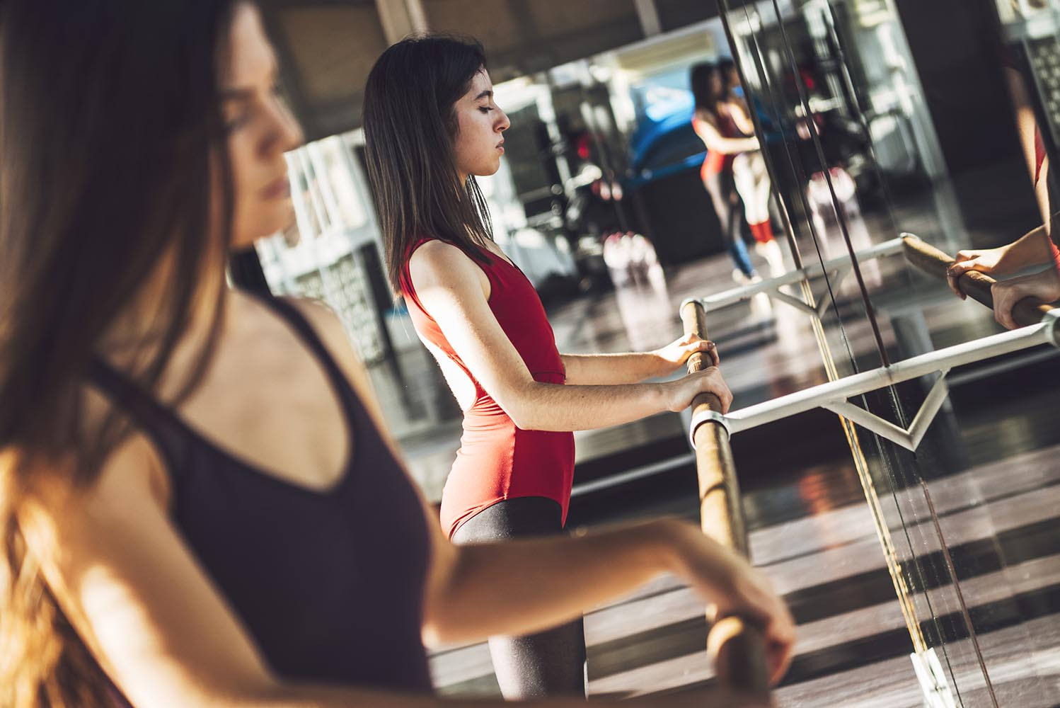 Young ballet dancer working out in studio