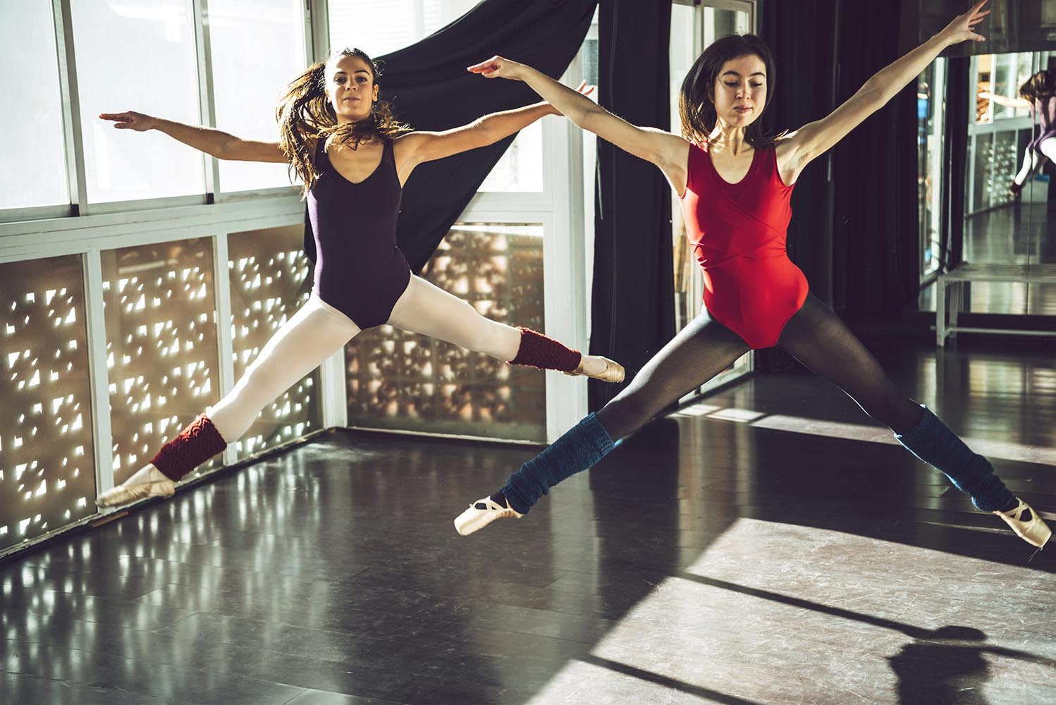 Dancers in jump above ground