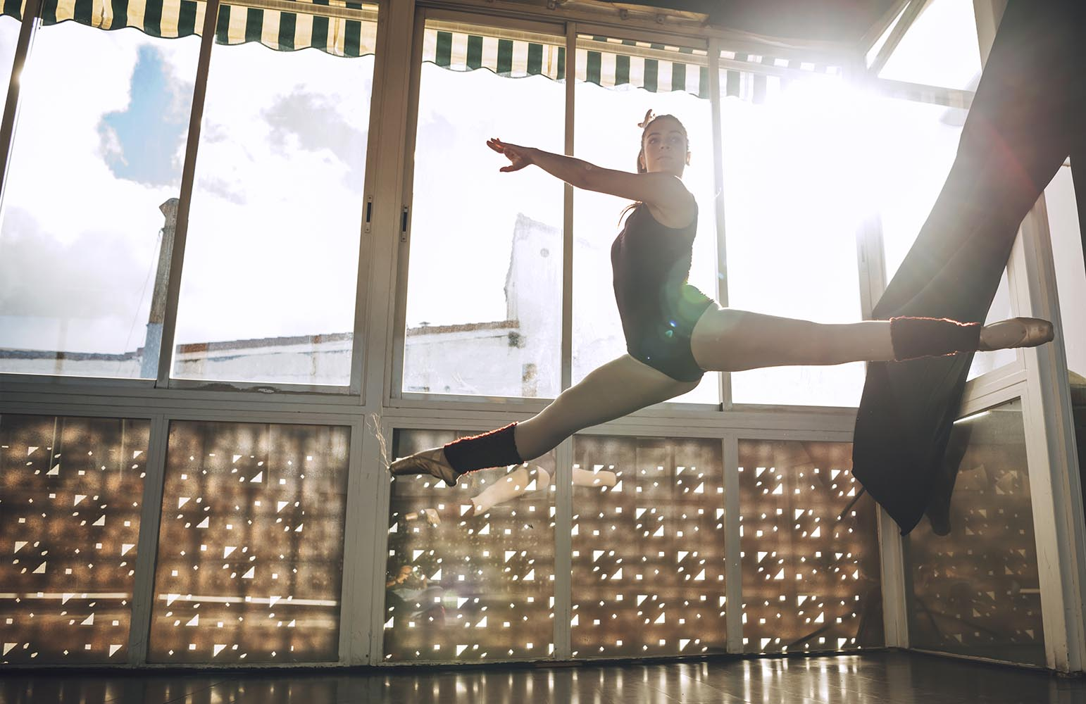Dancer flying in jump above ground