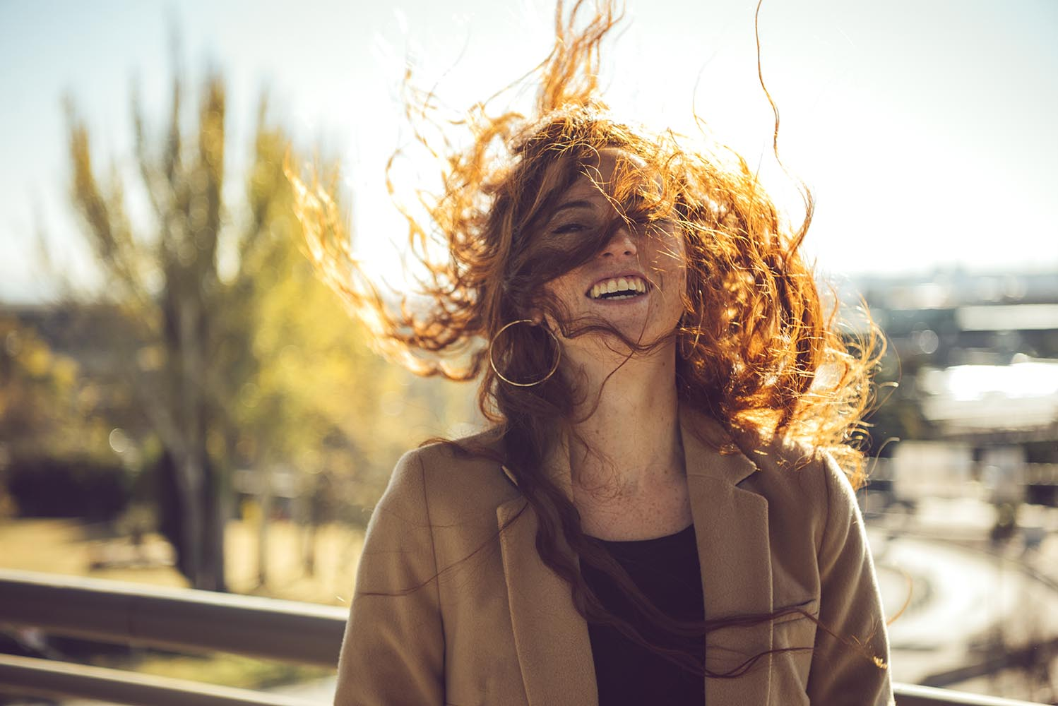 Happy woman with flying hair