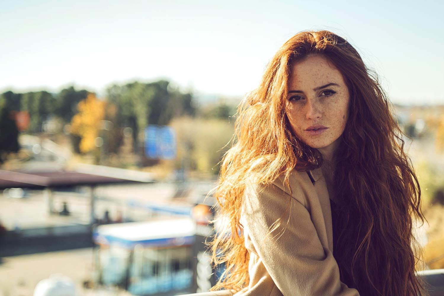 Beautiful redhead woman in sunlight