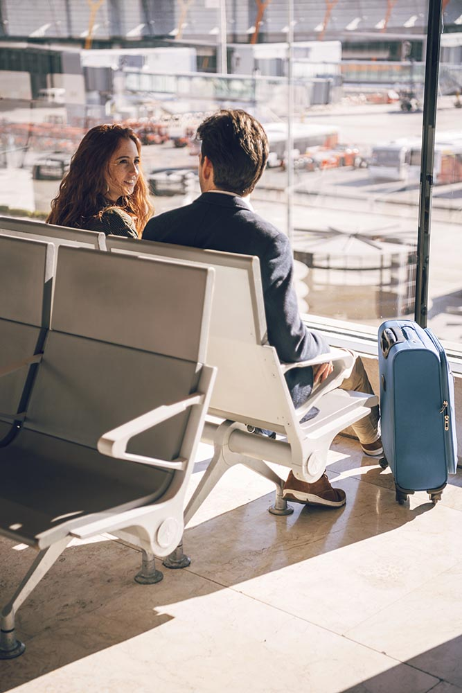 Man and woman sitting in airport