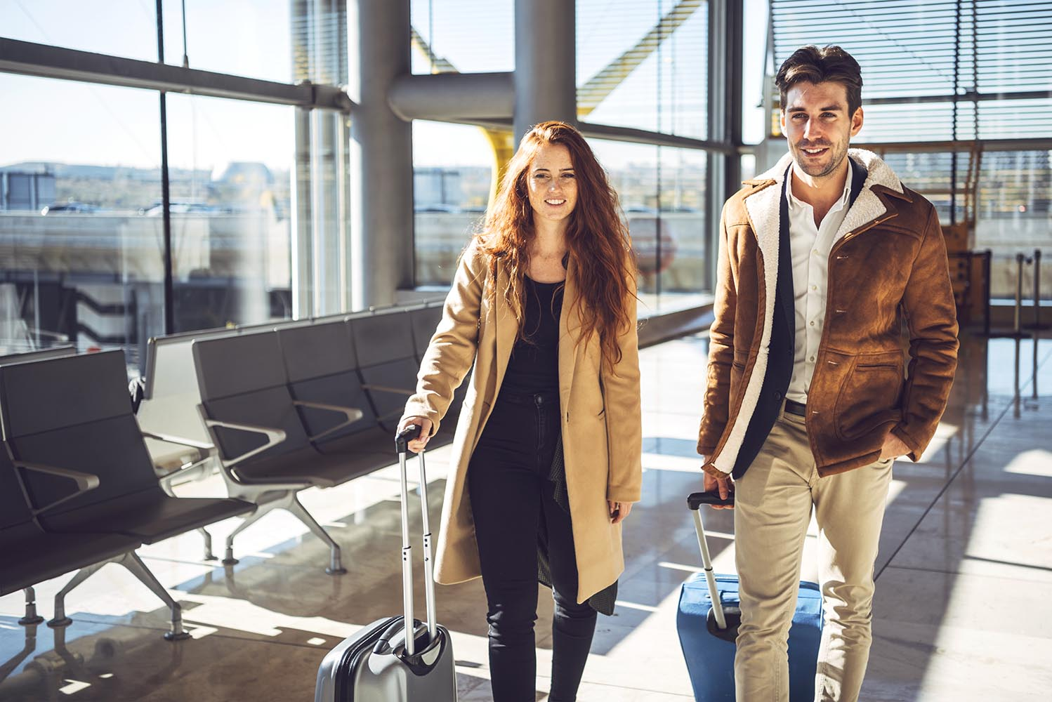 Cheerful couple walking in terminal