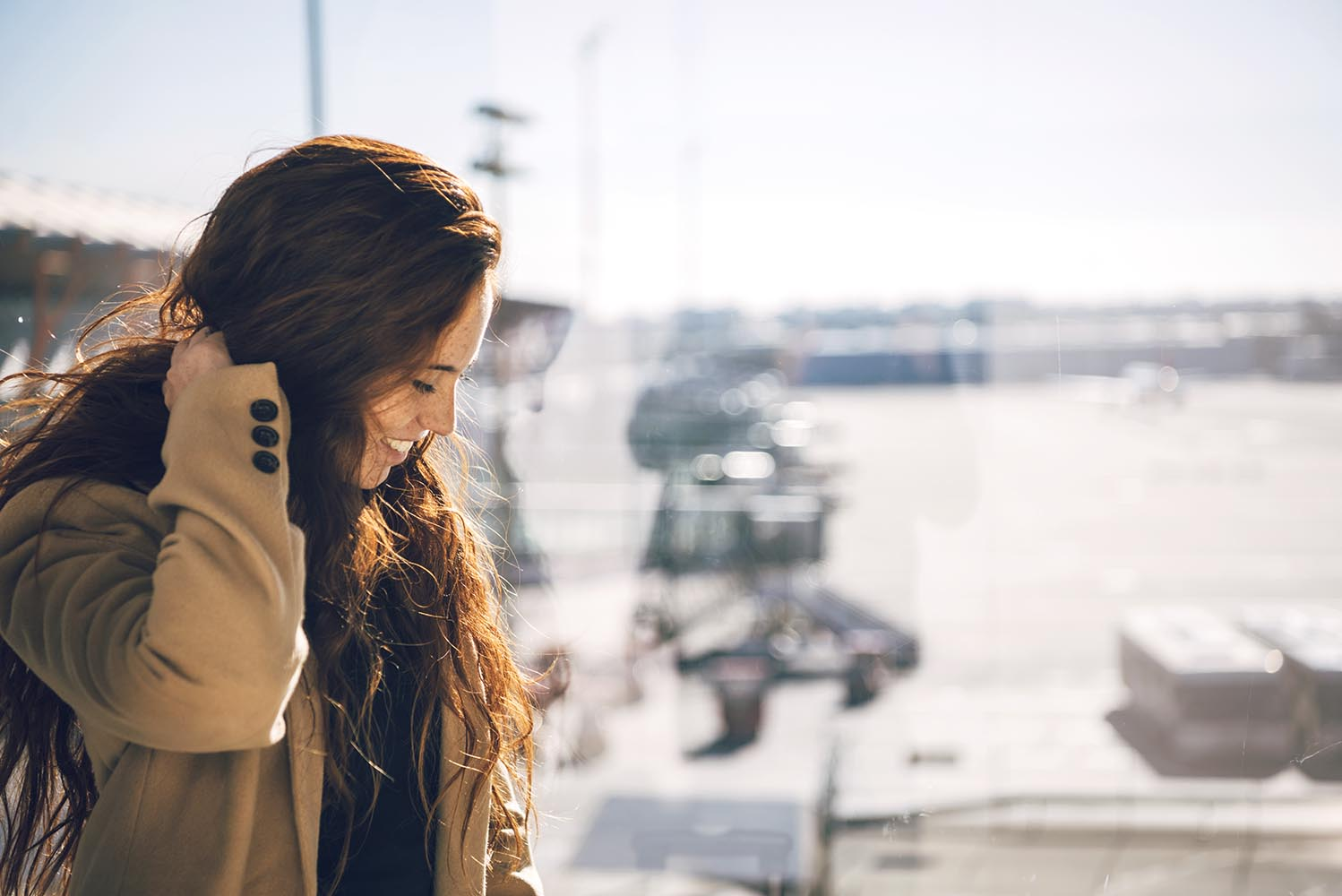 Cheerful redhead woman in airport