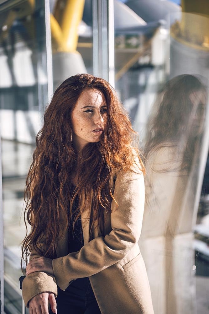 Woman with red hair in airport