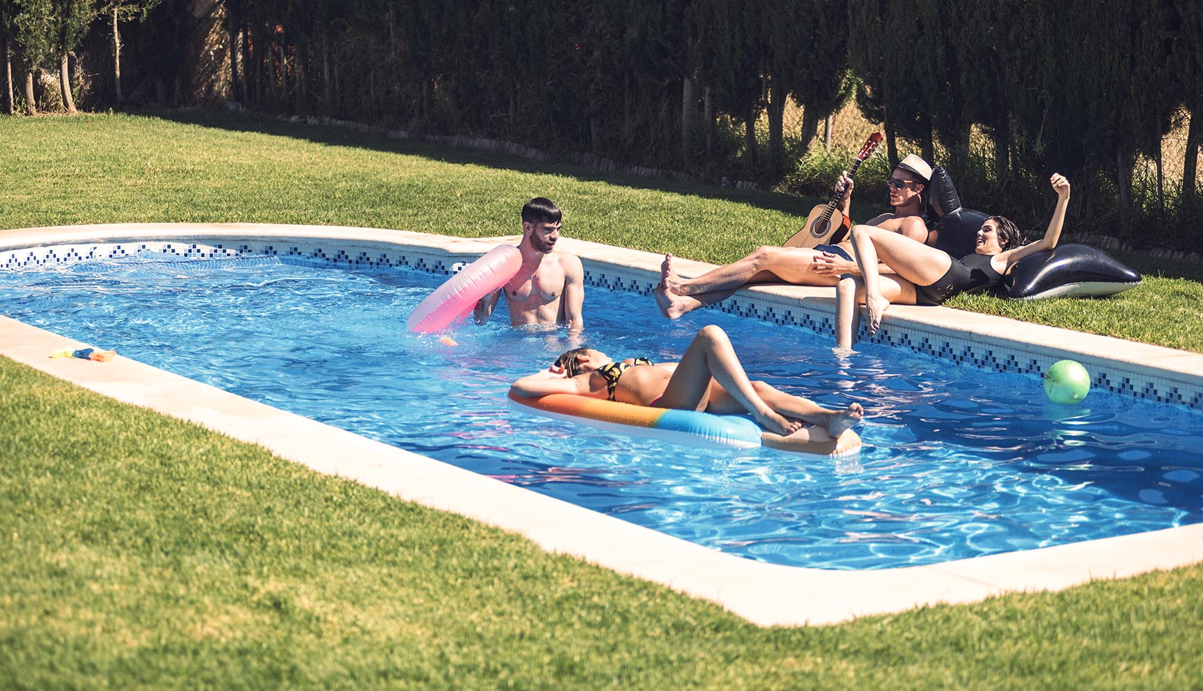 People relaxing in pool together
