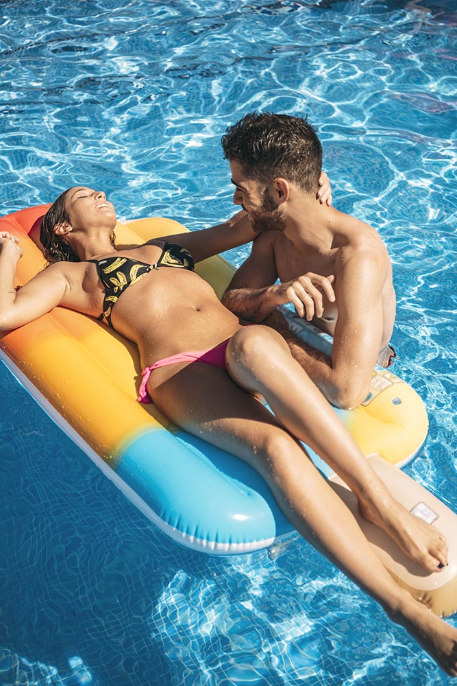 Young couple resting in pool