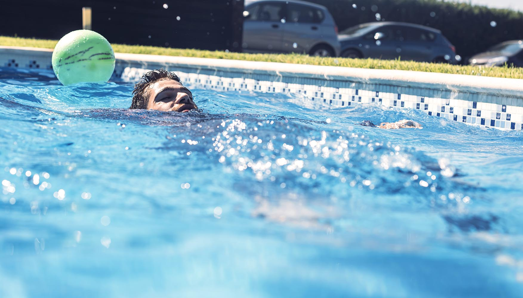 Man floating in swimming pool