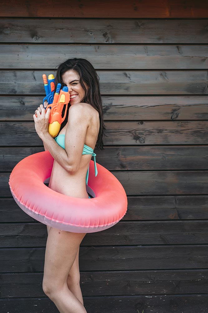 Young lady with two water guns posing