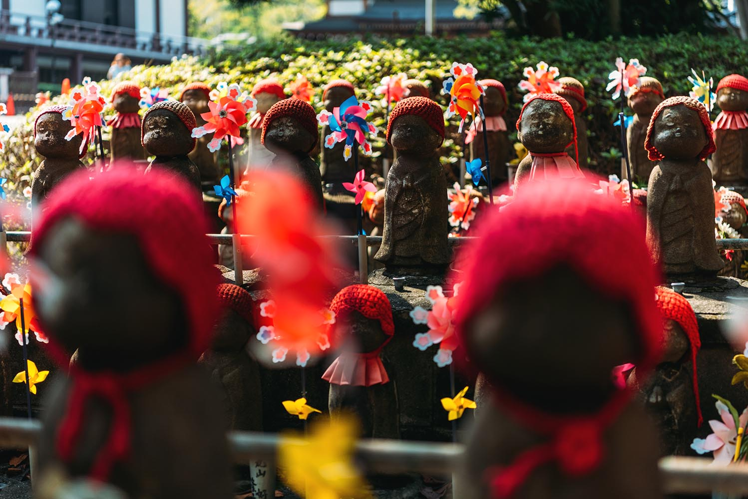 Jizo statues with decoration and flowers at Zojoji temple, in To