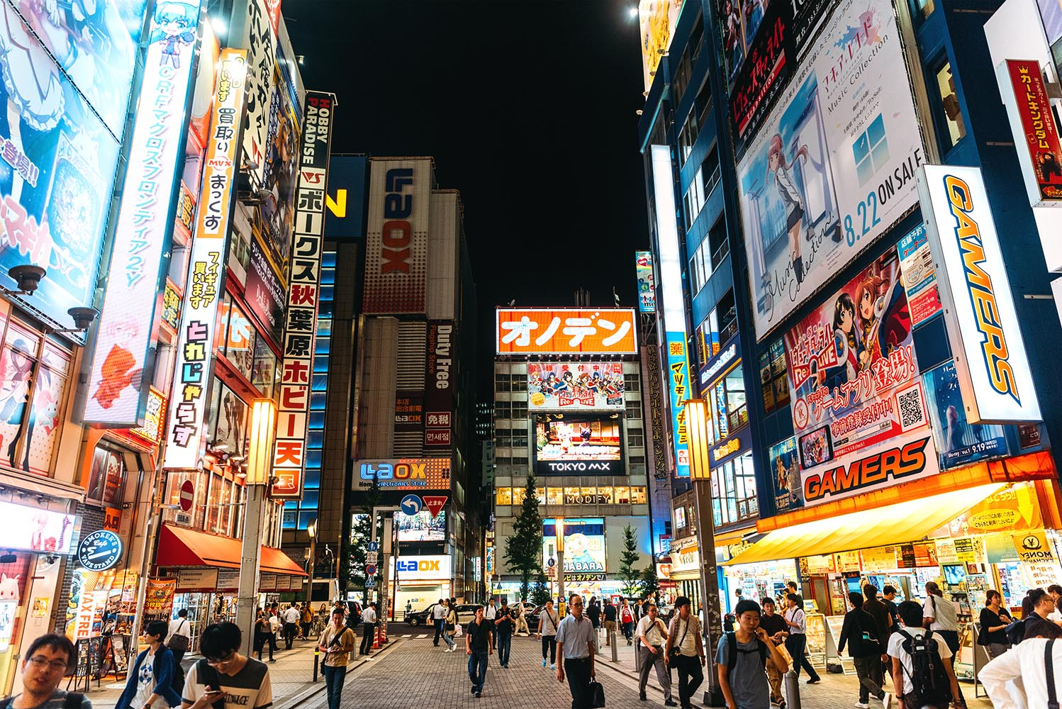 Neon signs cover buildings in the consumer electronics district